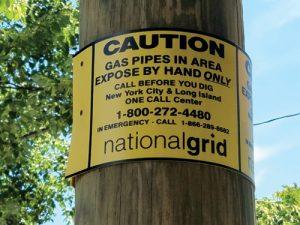 Utility pole wrap pipeline marker
