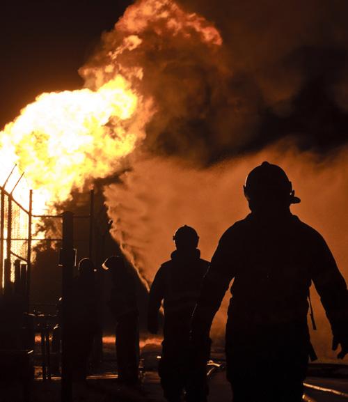 Firemen responding to gas fire